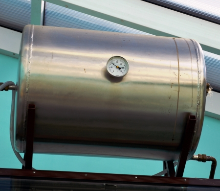 Solar collector tank container for water heating and water temperature thermometer
