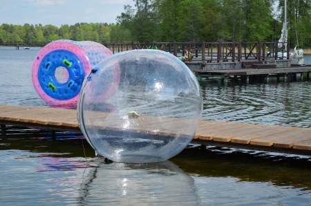 bloating: Zorbing air bubbles on water  Marina resort lake in Trakai  Most visited tourist place in Lithuania