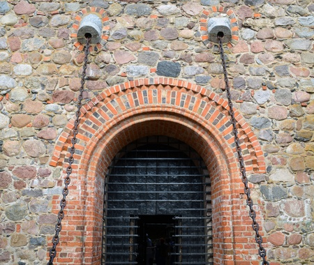 Entrance to hall of castle gates hang on chains. Trakai castle details XIV, XV century architecture.
