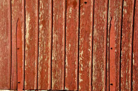 Fragment of old brown painted building wall made of wooden planks  photo