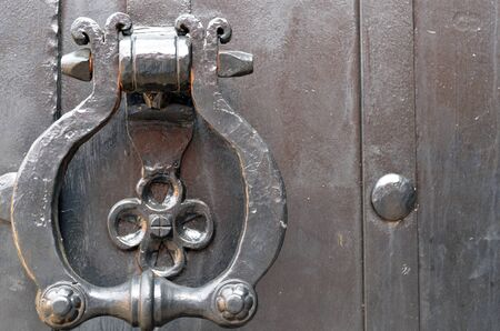 Vintage metal door handle  Ancient architecture background   photo