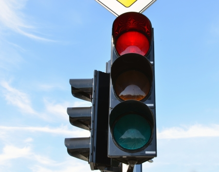 Red color on traffic light with beautiful blue sky in background  photo