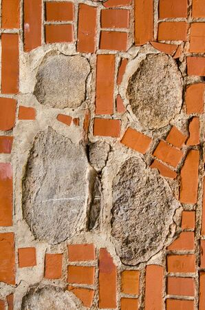intresting: Intresting old wall fragmentmade of red bricks and stones  Architectural background  Stock Photo
