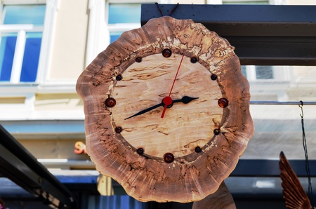 Handmade wooden clock decorated with amber flint stones   Stock Photo