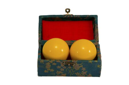 Yellow pool balls in ancient vintage retro box isolated on a white background  photo