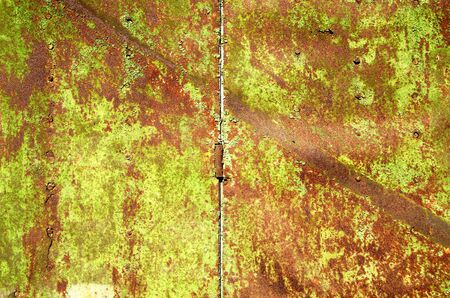 Background of old rusty steel garage door and hinge   photo