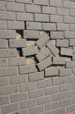 Small tiled sidewalk. Few stolen ones. Background. photo