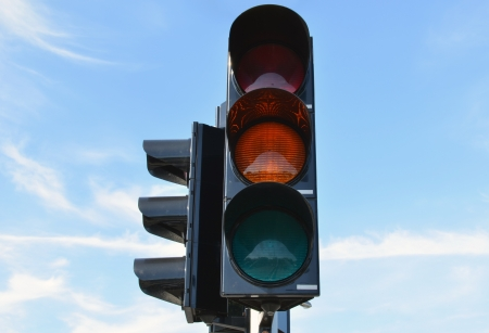Yellow color on traffic light with beautiful blue sky in background  photo