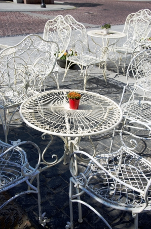 Decorative white tables and chairs on sidewalk of outside cafe cofee-house. Stock Photo - 14211086