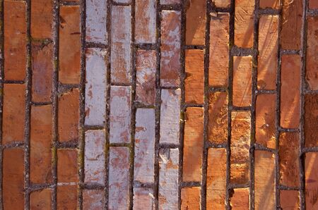 Wall made of red and colored bricks  Architectural decision   photo