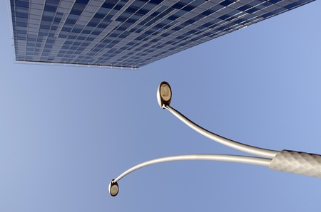 High glass building and street lights in blue sky   photo