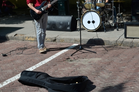 Street music day and musician plays guitar  Attempt to earn on their creations in public place   Stock Photo