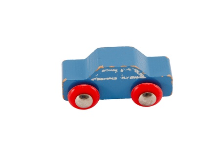 Wooden blue vintage toy car isolated on white background   photo