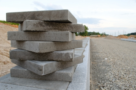 Pavement tiles on new sidewalk. New road construction works.  Stock Photo