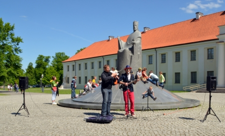 VILNIUS, LITHUANIA MAY 2012. Musicians playing instruments and singing near great duke Mindaugas sculpture. Street Music Day.
