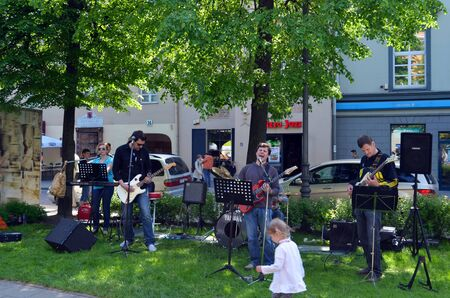 VILNIUS, LITHUANIA MAY 2012. Musicians playing guitar and singing in city center. Street music day. Free event.