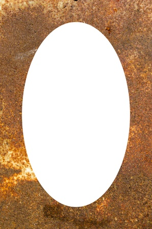 Isolated white oval place for text photograph image in center of rusty fragment of an old metal plate.  photo