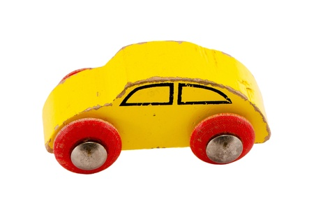 Wooden yellow retro toy car isolated on white background   photo