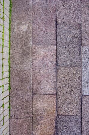 Block wall and tiled path fragments. Construction background. photo