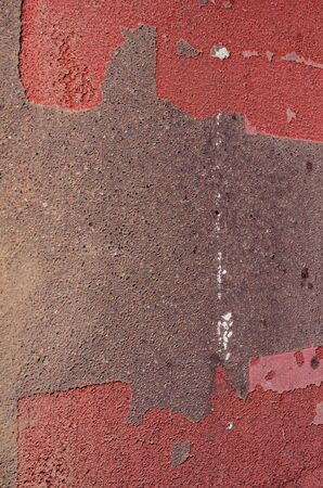 Fragment of asphalt road with red pointed pedestrian crossway   photo