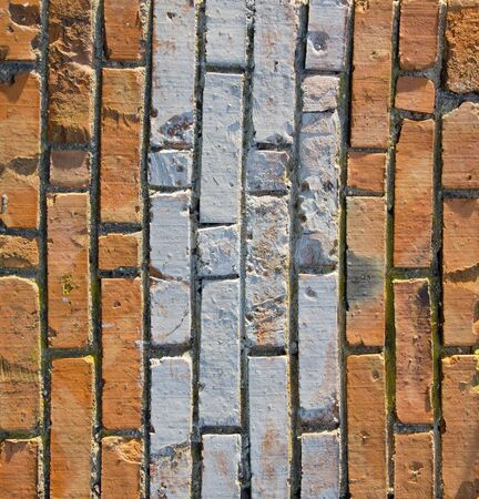 Wall made of red and colored bricks. Architectural decision.  photo