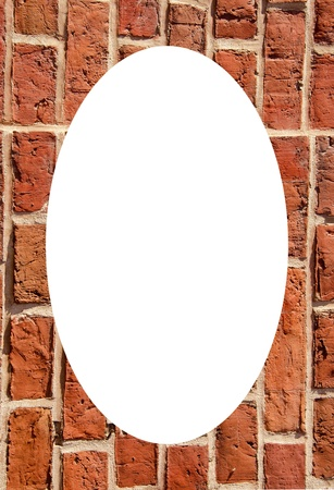 Old brick wall built of clay bricks. Isolated white oval place for text photograph image in center of frame.