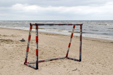 Steel metal football goal gate on sea sand  Active recreation on beach seaside   photo