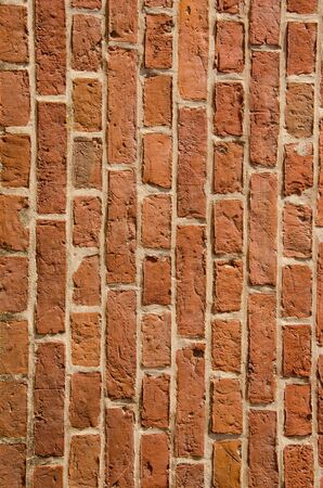 Wall built of red clay brick fragment. Architectural backdrop.  photo