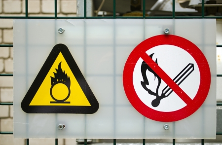Fire Warning Signs Near Compressed Oxygen Gas Cylinders Stock Photo
