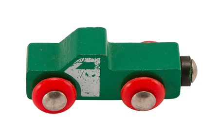 Wooden green retro toy car isolated on white background   photo