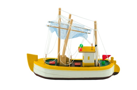 Wooden boat ship model decoration isolated on white  Handmade object   photo