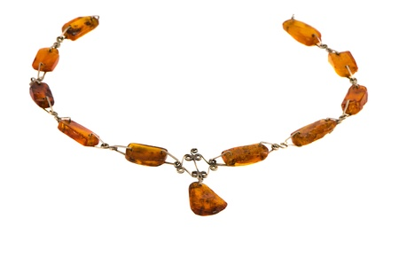 Amber gold color stone necklace isolated on white background