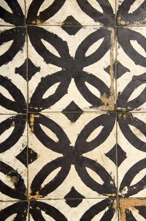 Antique floor tiles abraded backdrop in corridor