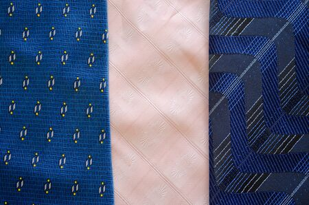 Three cravat tie scarfs texture pattern background  Blue and pink material fashion sewings   photo