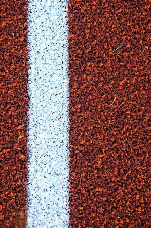 Stadium running track surface closeup background  Interesting textures   photo