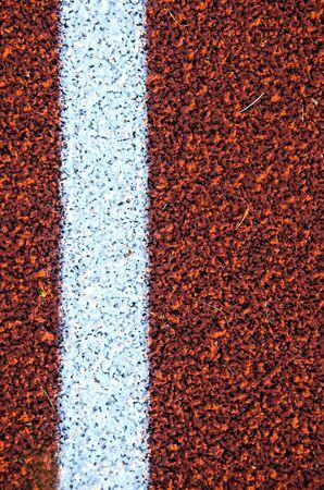 Stadium running track surface closeup background  Interesting textures