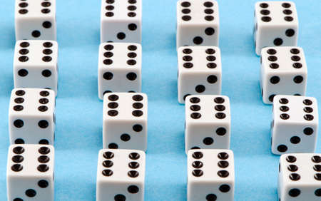 Lot of white gamble dice with six black dots on blue background Stock Photo - 15969209