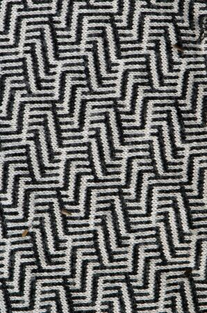 Interesting closeup texture pattern of garment dress cloth black and white ornaments