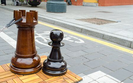 huge chess figures outdoor near bicycle path  People fun entertainment play object in street  photo