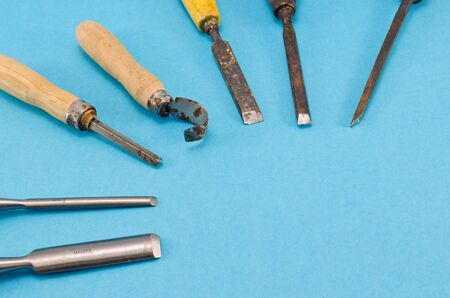 graver: chisel graver carve tools collection for wood work on blue background. place for text.  Stock Photo