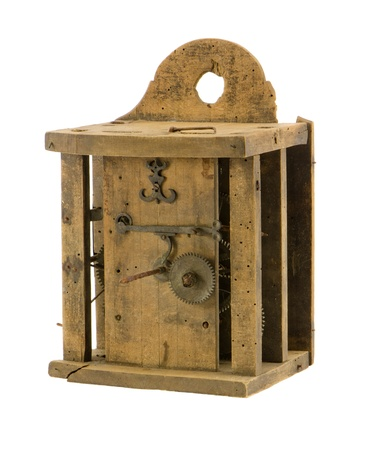 Retro wooden clock box and mechanism gear wheel residue isolated on white  photo