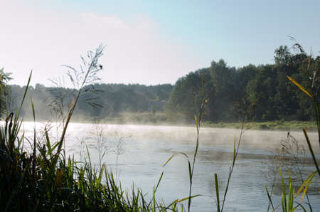 to other side: morning fog on river and mysterious house on other side.