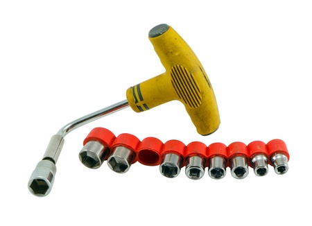 spaner: universal tool kit, demountable wrench tommy spanner heads with plastic handle isolated on white  Stock Photo