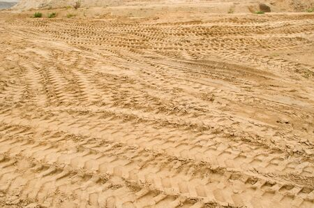 many truck car tracks near sand pit construction.  photo