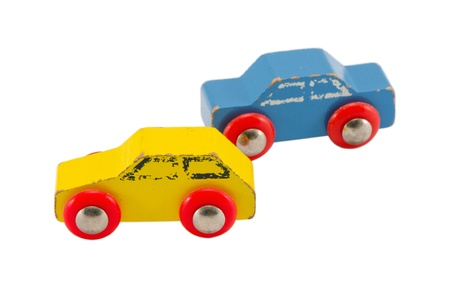 pair of wooden blue and yellow retro vintage toy cars isolated on white background   photo