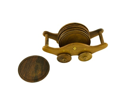 casters: Wooden ornamented pallet holder on casters and side round coaster isolated on white background