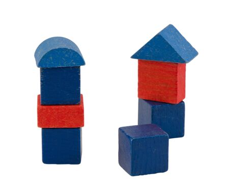colorful red blue wooden log toy tower constructions stand isolated on white   Stock Photo