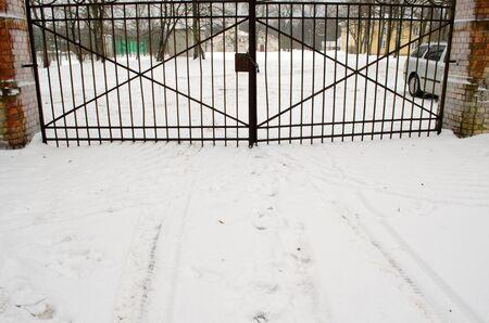 locked closed retro steel park gates in winter
