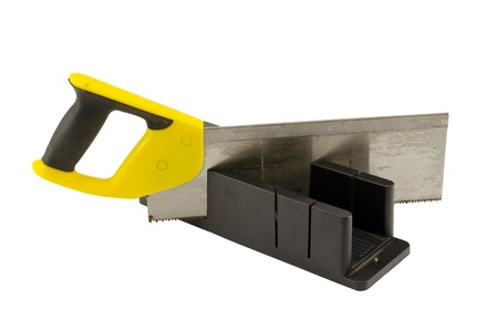 miter: plastic hand saw and angle cut miter box tool isolated on white background  Stock Photo