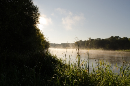 morning misty fog rise from flowing river water   photo